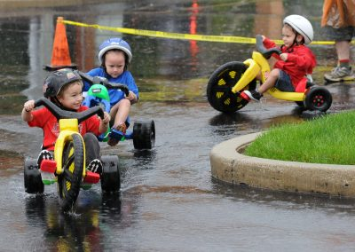 A Little Rain is No Match for These Big Wheel Racers