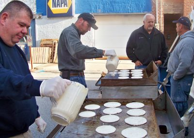 Cooking the 'cakes at the Pancake Breakfast